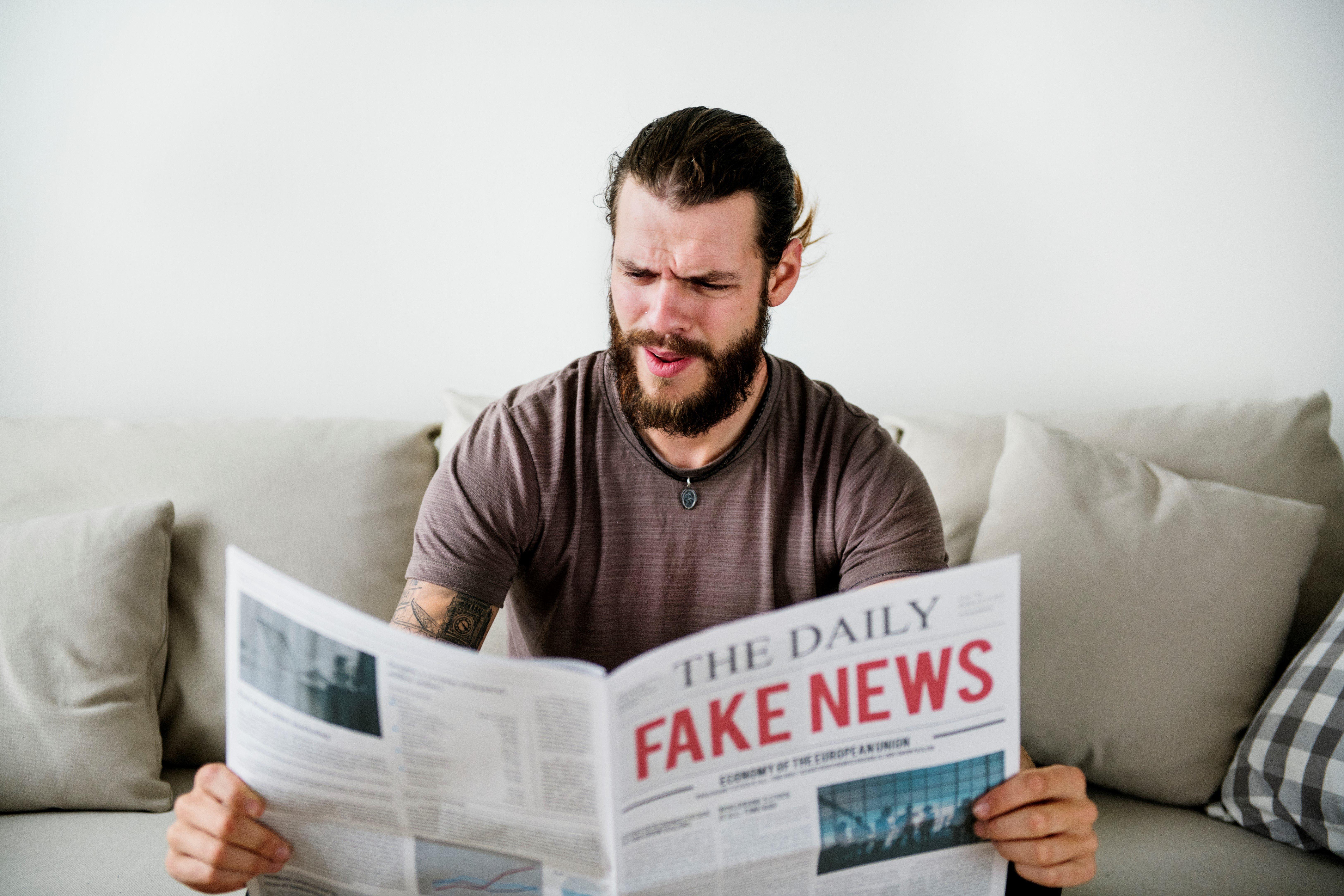fake-news-headline-on-a-newspaper-PDTG7PC