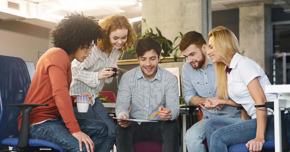 group-of-young-coworkers-discussing-new-marketing-8UGDA7W